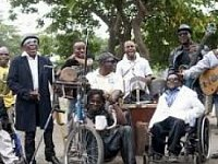 Conference Call Over Disabled Street Musicians